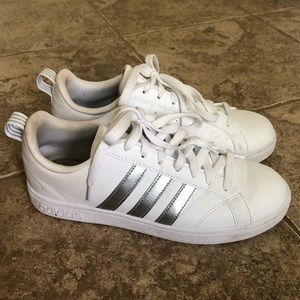 Adidas sneakers with silver stripes